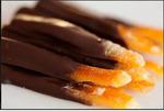 Апельсиновые палочки в тём. шоколаде, в креманке. Вес 100 гр.