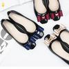 Женские резиновые туфли с бантиками