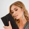 Стильный клатч-конверт на текстильной основе, декорированный бусинами на лицевой стороне.