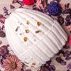 Шапка вязаная на трикотаже, с цветными камнями и с жемчугом, с отворотом, молочная